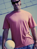 Young Man Standing Behind a Volleyball Net Photographic Print