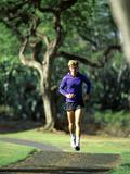 Man Jogging on a Path Photographic Print
