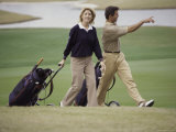 Young Couple Walking on a Golf Course Photographic Print