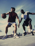 Two Young Men Playing Basketball Photographic Print