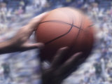 Hands Grabbing a Basketball Photographic Print