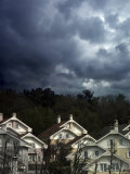Moody Clouds Over House Tops Photographic Print