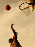 Side Profile of a Mid Adult Man Playing Basketball Photographic Print