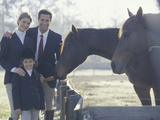 Portrait of a Family Standing Beside Two Horses Photographic Print