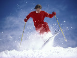 Skier in Red Against Blue Sky Background Photographic Print