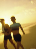 Couple Running on The Beach Photographic Print
