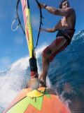 Low Angle View of a Mid Adult Man Windsurfing Photographic Print