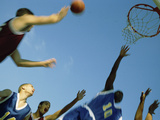 Low Angle View of Group of Young Men Playing Basketball Photographic Print