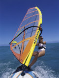 Young Woman Windsurfing Photographic Print