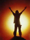 Victorious Climber Silhouetted by the Sun Photographic Print