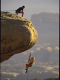 Climber Dangling Photographic Print