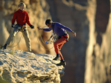 Two Hikers with Ropes at the Edge of a Cliff Photographic Print
