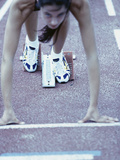 Young Female Runner at the Starting Position Photographic Print