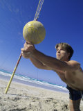 Man Diving for Volleyball on Beach Photographic Print