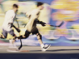 Motion Blurred Image of Teens Playing Street Hockey Fotografie-Druck
