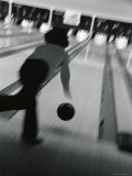Monochromatic Image of a Woman Bowling Photographic Print