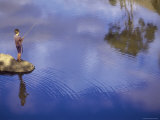 Boy Fishing from a Rock on a Pond Photographic Print
