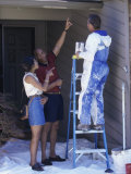 Young Couple Standing Near a Painter on a Ladder Photographic Print