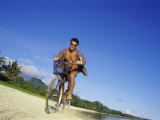 Man Riding a Bicycle on the Beach Photographic Print