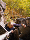 High Angle View of Young Woman Rock Climbing Photographic Print