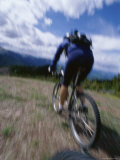 Motion Blurred Image of a Mountain Biker Photographic Print