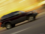 Side View of a Speeding Car Photographic Print