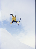 Young Man in Mid Air Wearing Skis Photographic Print