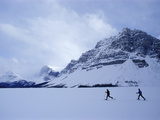 Cross Country Skiers by a Mountain Photographic Print