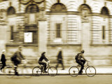 Cyclists on a City Street Photographic Print