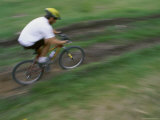 Motion Blurred Image of a Cyclist on a Path Photographic Print