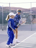 Woman Teaching a Girl How to Play Tennis Photographic Print