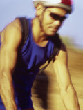Blurred Image of a Man Cycling Photographic Print