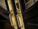 Close-up of Golden Handles on a Door Photographic Print