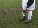 Muddy Legs of a Soccer Player Photographic Print