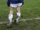 Muddy Legs of a Soccer Goalie Photographic Print