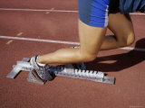 Low Section View of a Female Athlete on a Running Track Photographic Print
