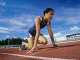 Close-up of a Female Athlete in The Starting Position on a Running Track Photographic Print