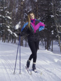 Portrait of a Young Woman Holding Ski Poles Photographic Print