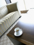 Cup and Saucer on a Coffee Table Photographic Print