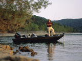 Man Standing in a Boat Fishing Photographic Print