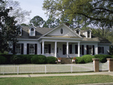 Traditional Home with White Picket Fence Photographic Print