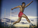 Male Jogger Leaping in a Field Photographic Print