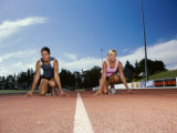 Two Female Athletes in The Starting Position on a Running Track Photographic Print