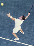 High Angle View of Man Serving a Tennis Ball Photographie