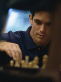 Chess Player Contemplating a Move Photographic Print