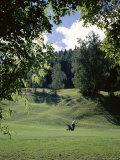Golfer Swinging Photographic Print