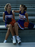Two Cheerleaders Sitting with Pom-Poms Photographic Print