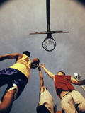 Low Angle View of Three Young Men Playing Basketball Photographic Print