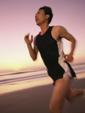 Mid Adult Man Jogging on the Beach Photographic Print
