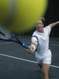 Tennis Player Hitting The Ball Photographie